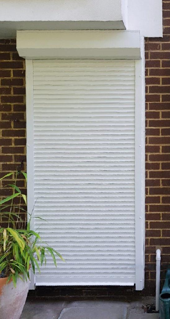 A SeceuroGlide 3800 Security Shutter in White