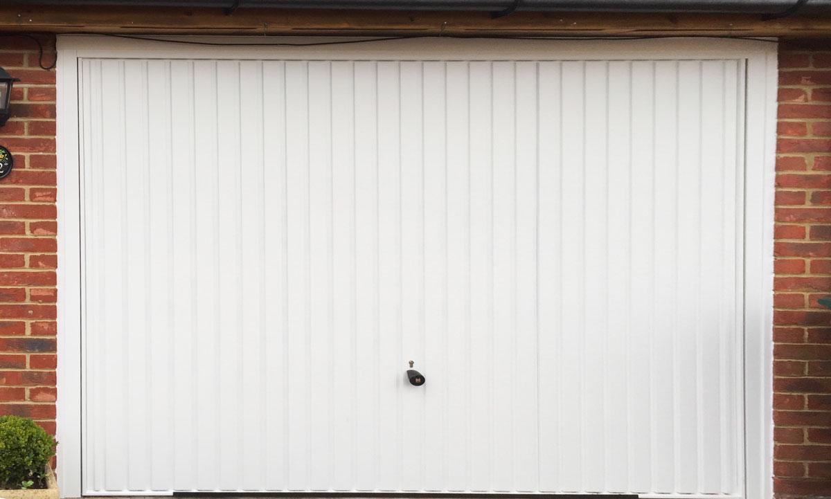 Hormann 2001 Vertical-Ribbed Retractable Garage Door in Traffic White