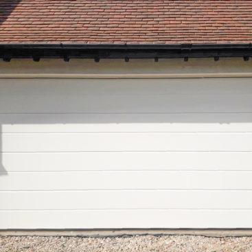 Hormann LPU42 Sectional Door in White Woodgrain