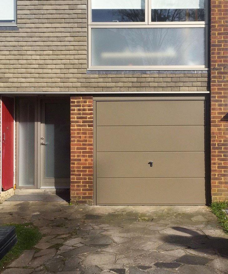 Fort Horizontal Wide-Rib Up and Over Canopy Garage Door in Beige Grey