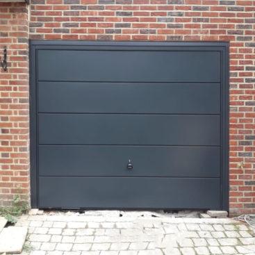Garador ASCOT wide ribbed Steel Up & Over Garage Door Finished in Anthracite Grey.