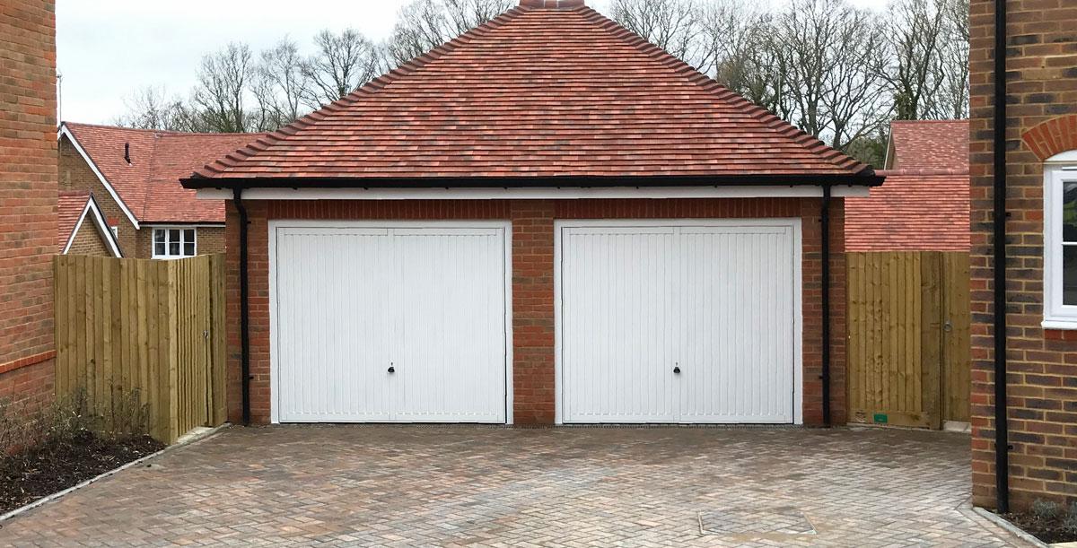 2 x Garador Sutton Retractable Garage Doors finished in Traffic White