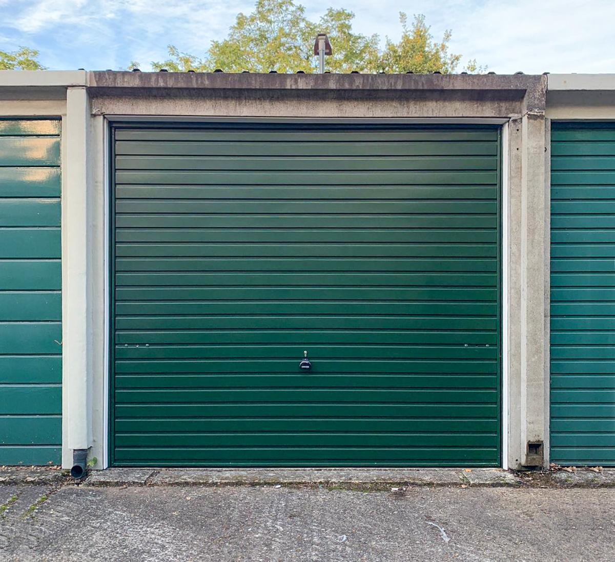 This Garador Steel Up & Over Garage Door Finished in Fir Green