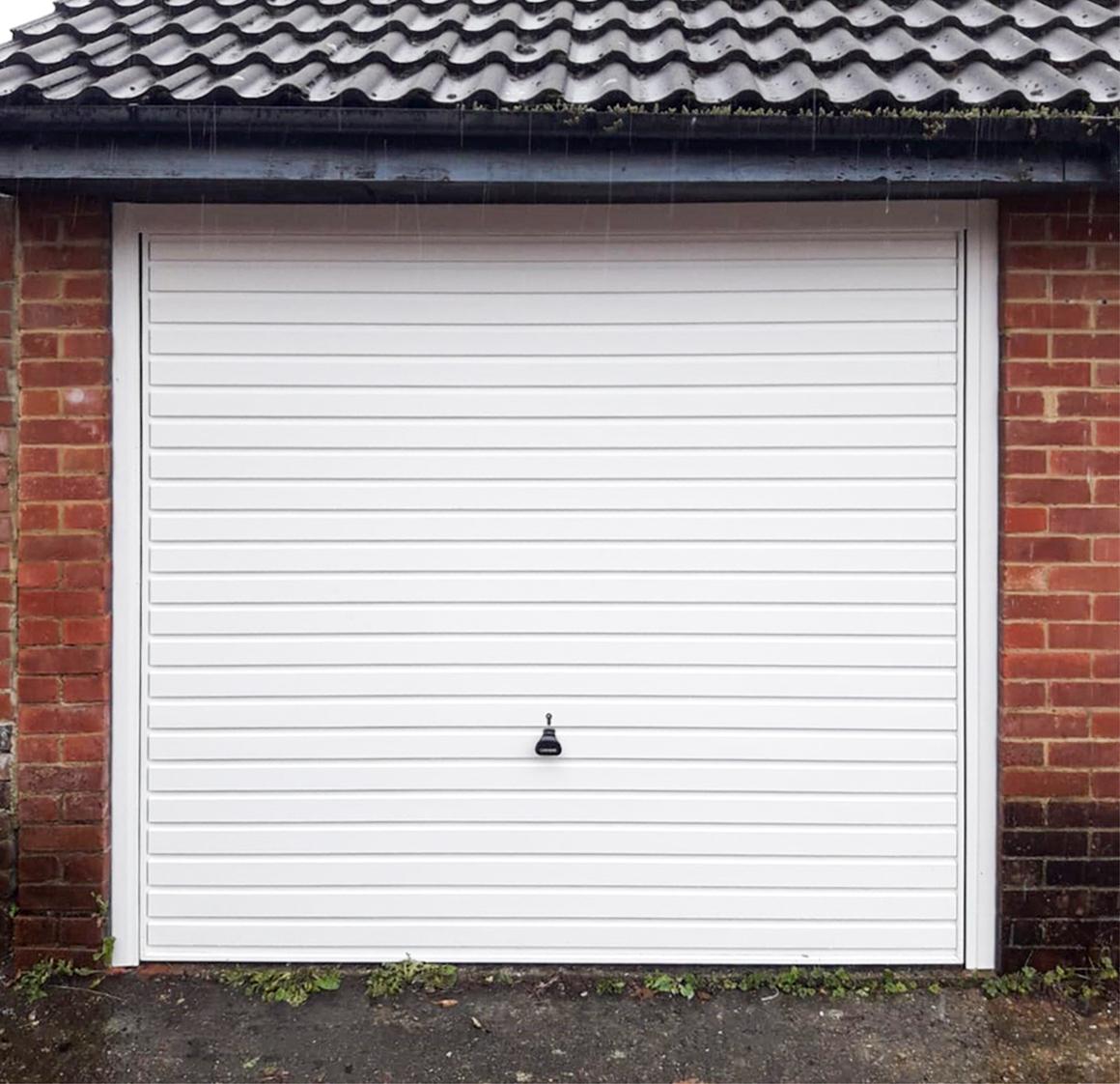 Garador Horizon Steel Up & Over Garage Door Finished in Traffic White & Installed by our Watford Branch.