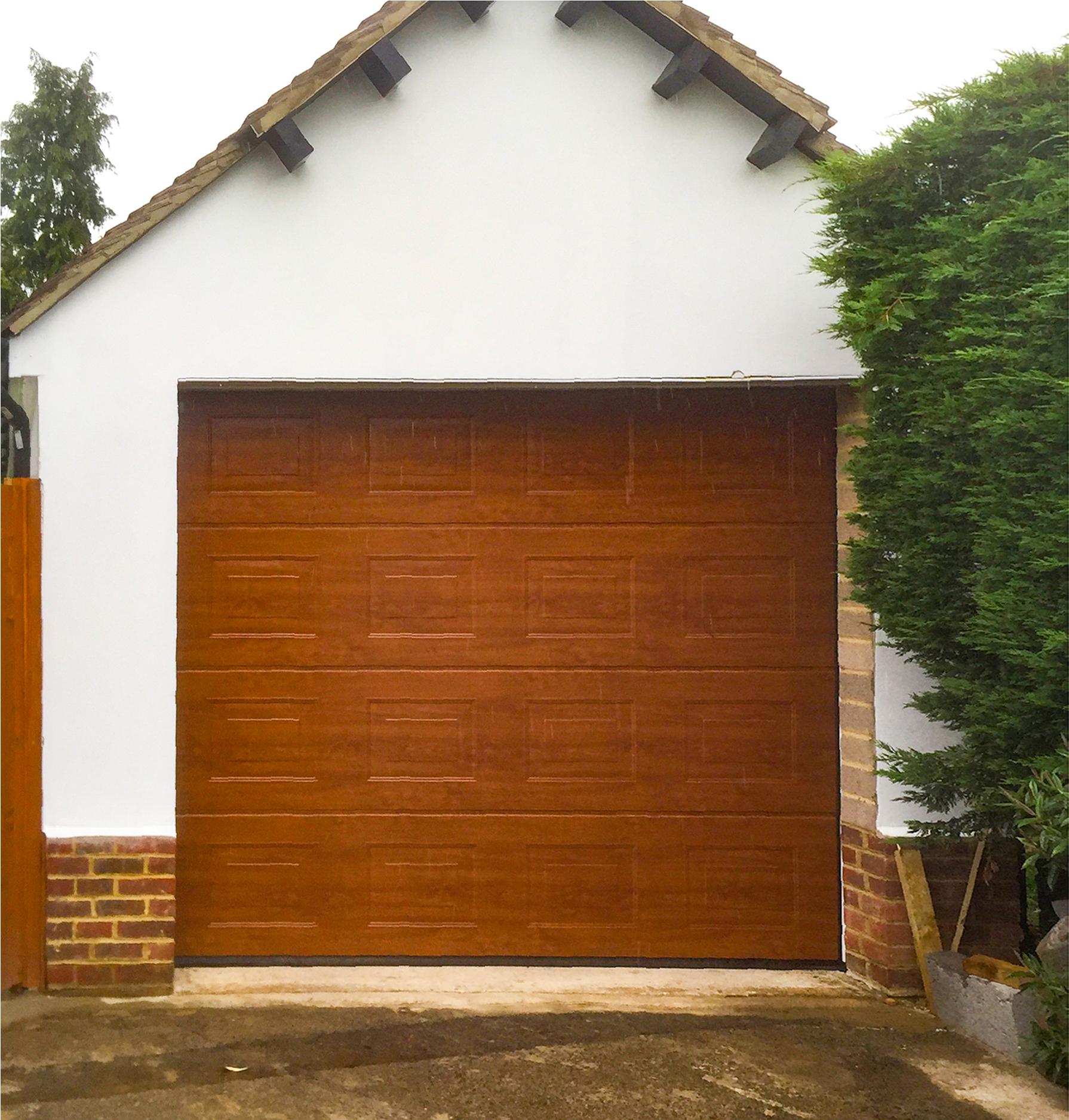 Hormann LPU 42 Panelled Insulated Sectional Garage Door Finished in Decograin Golden Oak