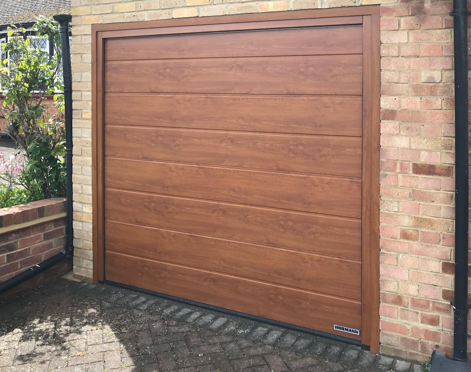 Hormann LPU42 M-Ribbed Sectional Garage Door finished in Golden Oak Decograin