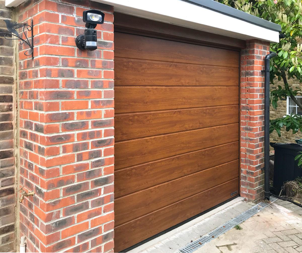 Hormann LPU42 Garage Door in a Golden Oak Decor