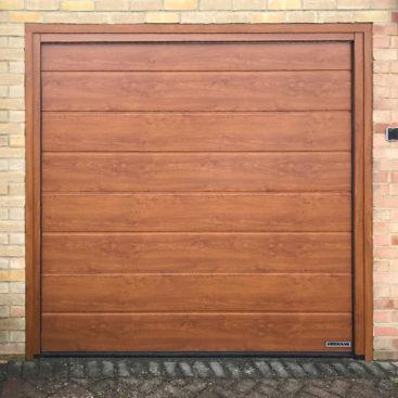 Hormann LPU42 Garage Door in a Golden Oak Decogr