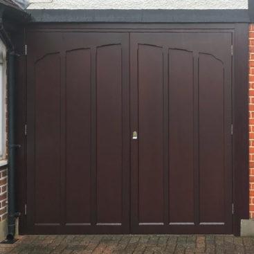 A Woodrite Twickenham Side Hinged Garage Door finished in Mahogany