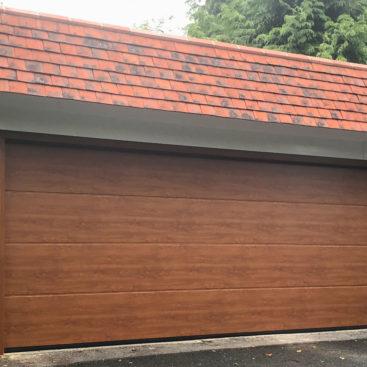 Hormann LPU42 L Ribbed Garage Door in Golden Oak