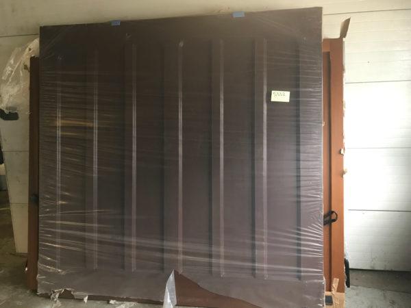 Apex Cornwall Tudor GRP retractable Garage Door in Dark Oak