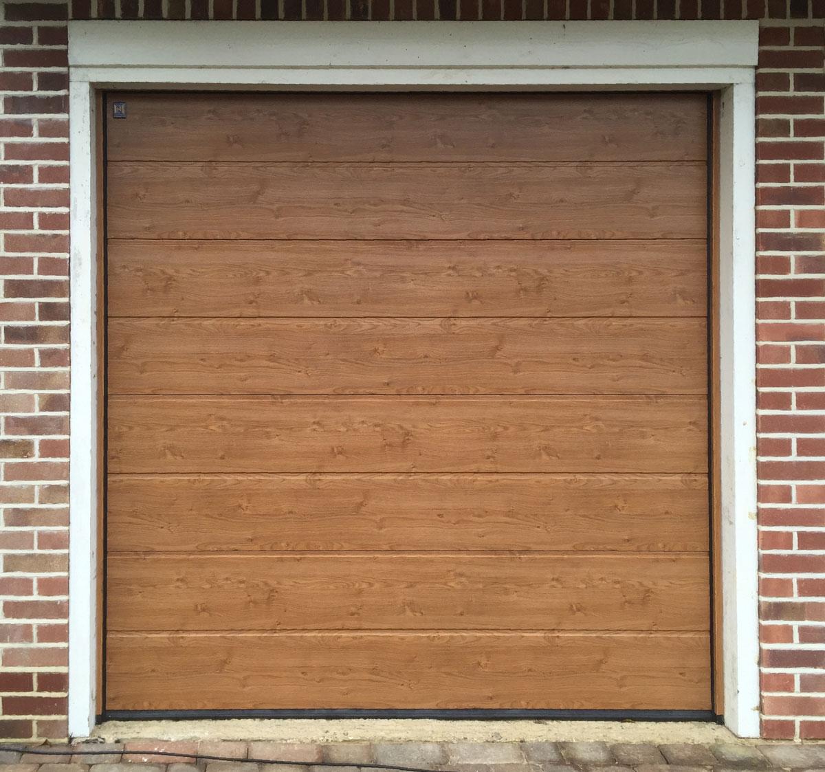 Hormann LPU42, M-Ribbed, Sectional Garage Door in Golden Oak Decograin