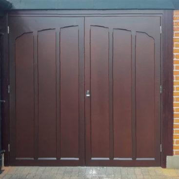 A pair of Woodrite Side-Hinged Garage Doors