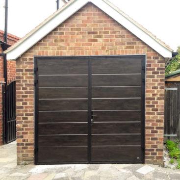 Ryterna Wide Horizontal Ribbed 50:50 Split Side Hinged Garage Doors Finished in Dark Oak Wood Effect