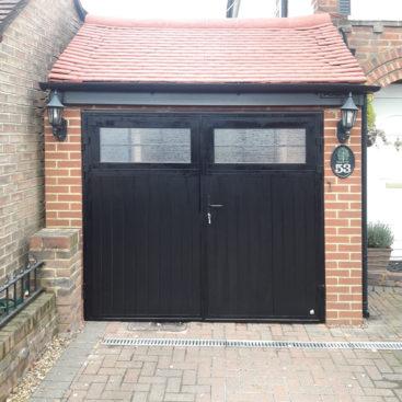 Ryterna Vertical Ribbed Side Hinged Garage Door Finished in Black