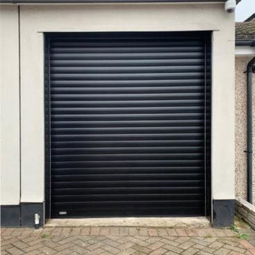 SWS SeceuroGlide Insulated Roller Garage Door Finished in Black & Installed in Stoneleigh
