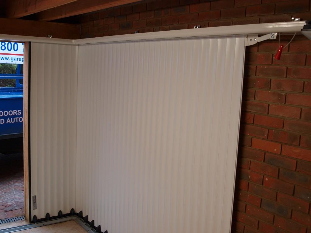 Sliding garage doors access