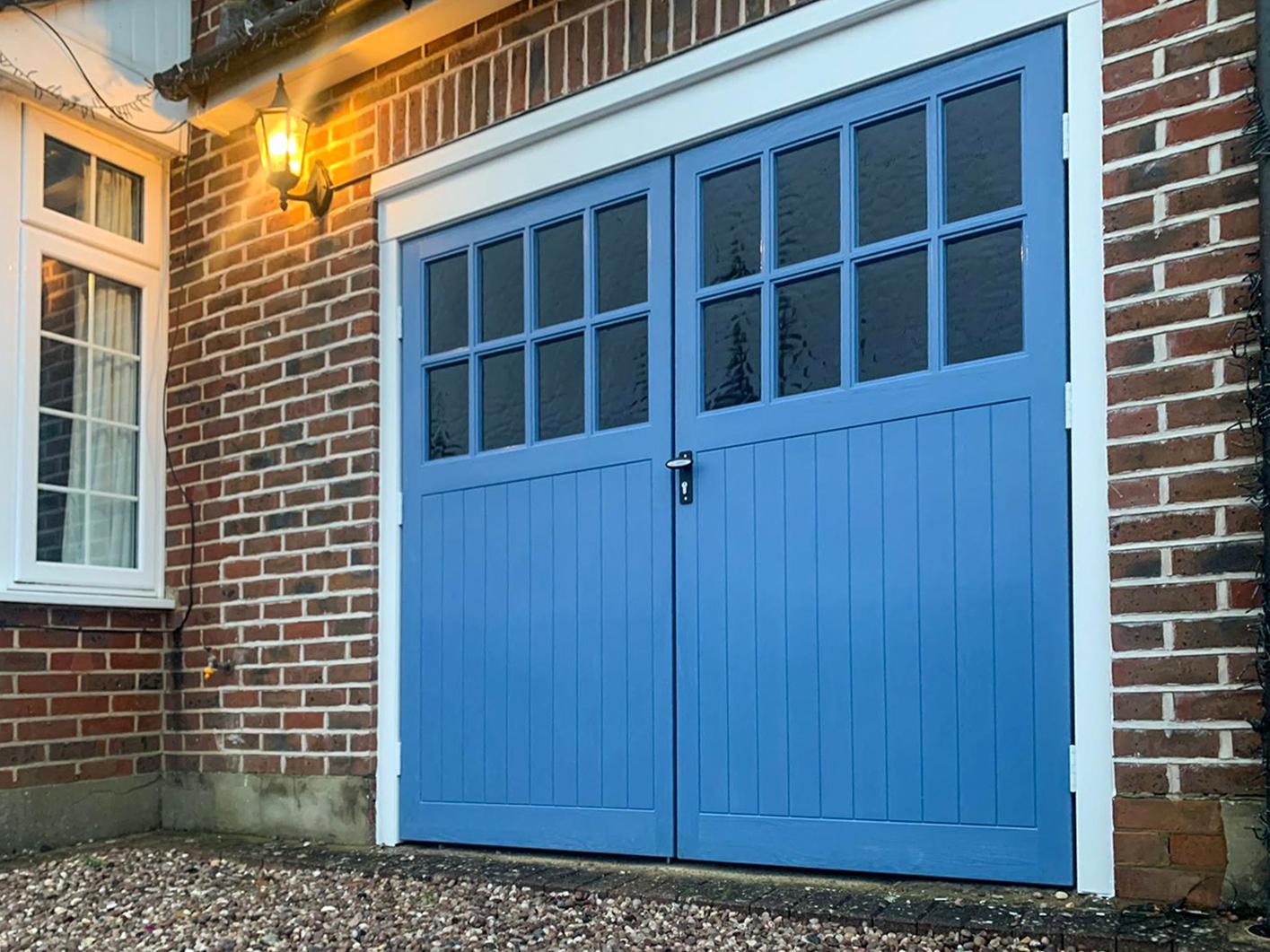 Wessex Sherwood Wood Grain GRP Side Hinged Garage Doors Finished in Wedgewood