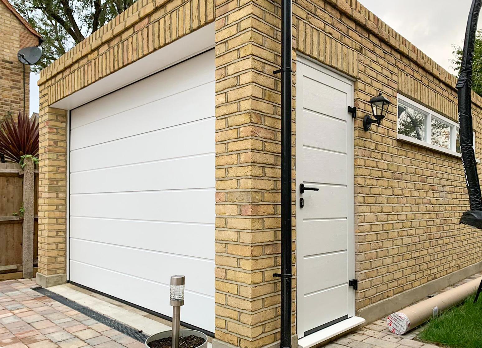 Hormann LPU42 sectional garage door and NT60 side door
