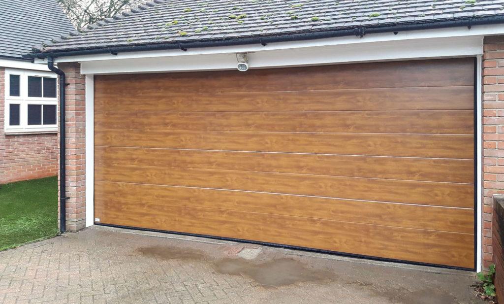 SeceuroGlide Elite Steel Sectional Garage Door in Golden Oak