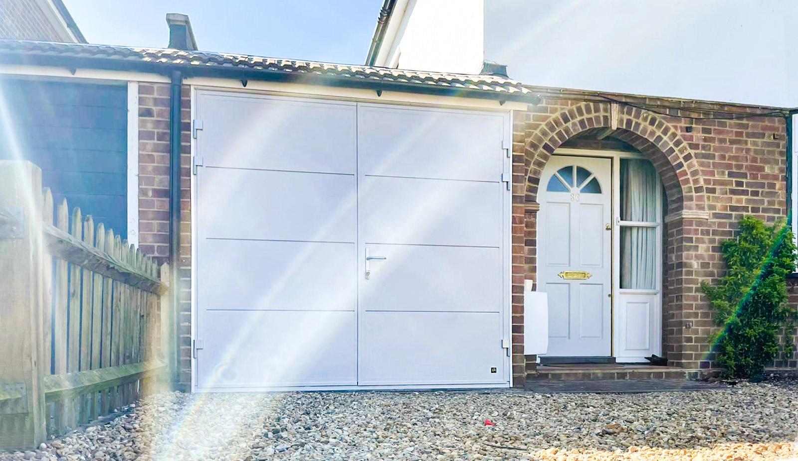 Ryterna Wide Horizontal Ribbed Insulated Side Hinged Garage Doors in Telegrey