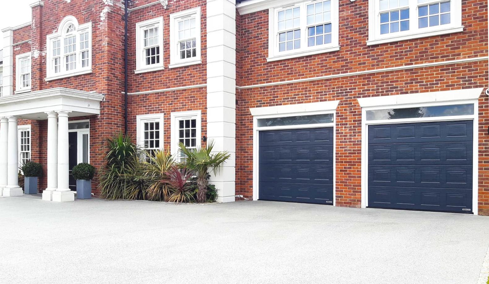 Hormann LPU42 S-Panelled Sectional Garage Doors in Anthracite Grey Woodgrain