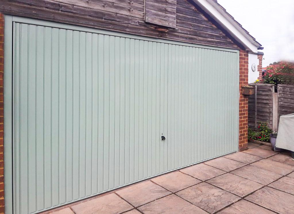 Garador Carlton Steel Retractable Double Up-and-Over Garage Door in Chartwell Green