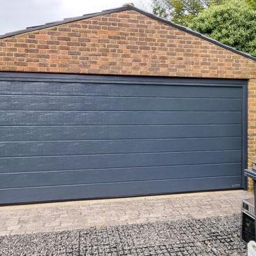 Hormann LPU42 Sectional garage door in Anthracite Woodgrain
