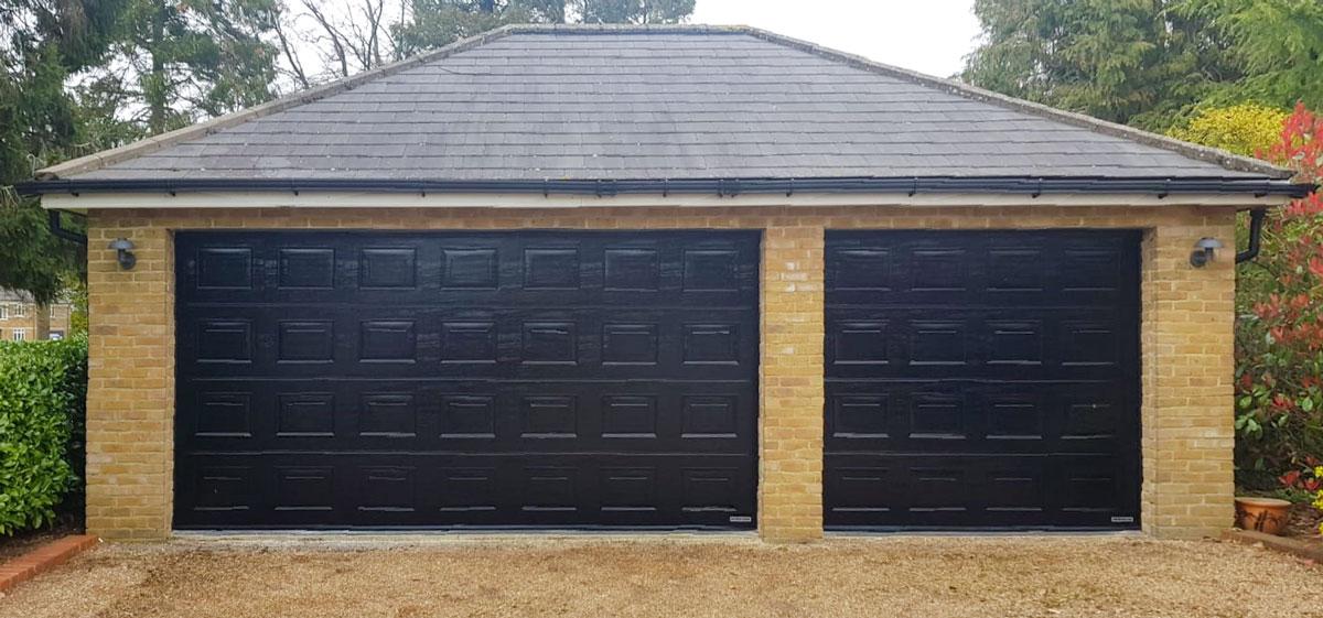 Hormann LPU42 Sectional Doors in Black Woodgrain
