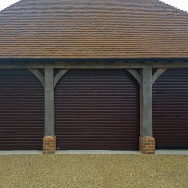 3 x SWS Securoglide Roller Garage Doors in a Rosewood Woodgrain