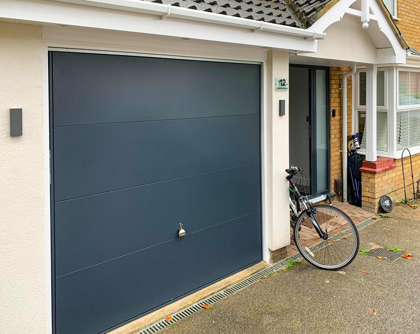 Garador Design 100 Wide Ribbed Steel Canopy Up & Over Garage Door Finished in Anthracite Grey