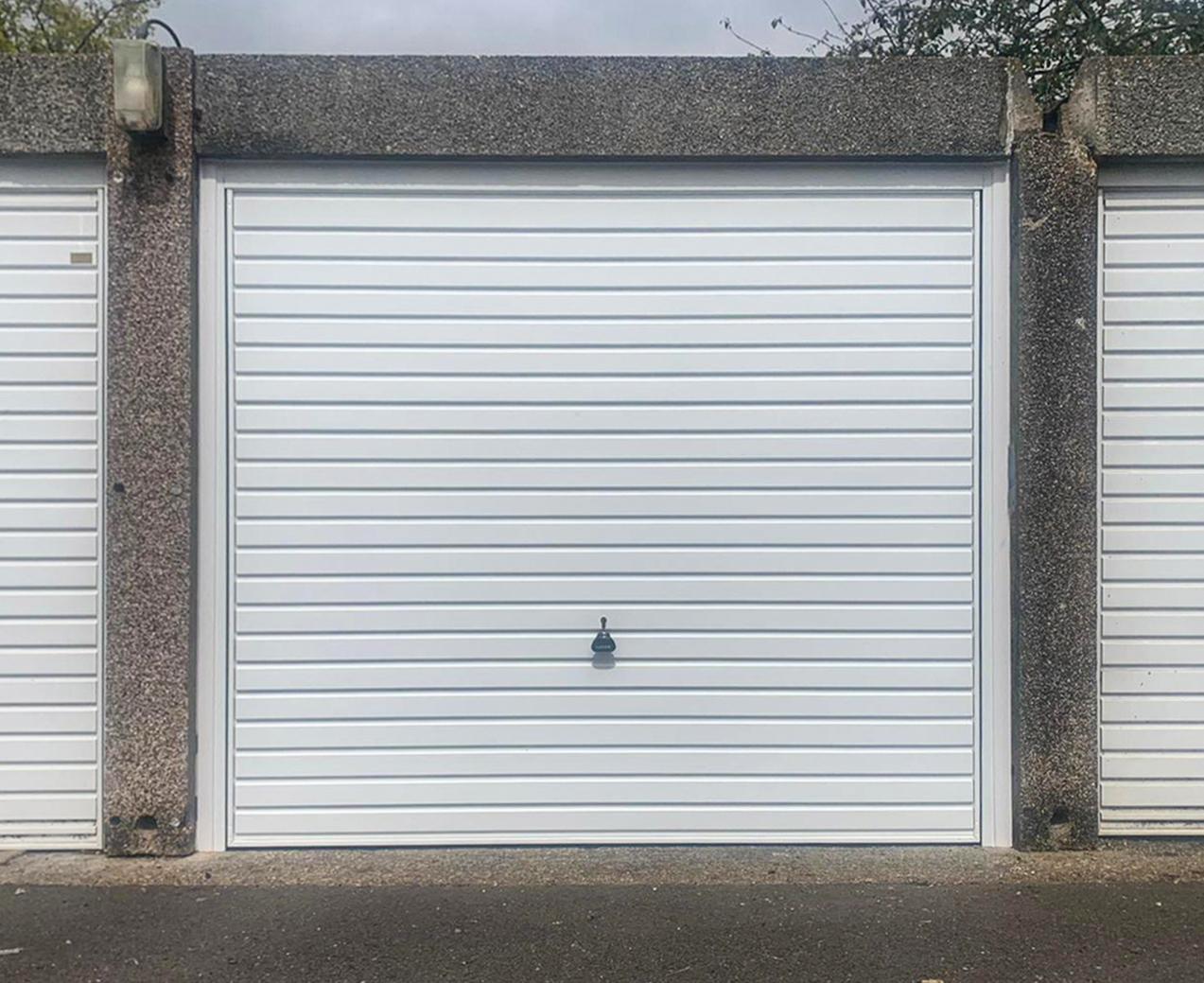 This Garador Steel Up & Over Garage Door Finished in White