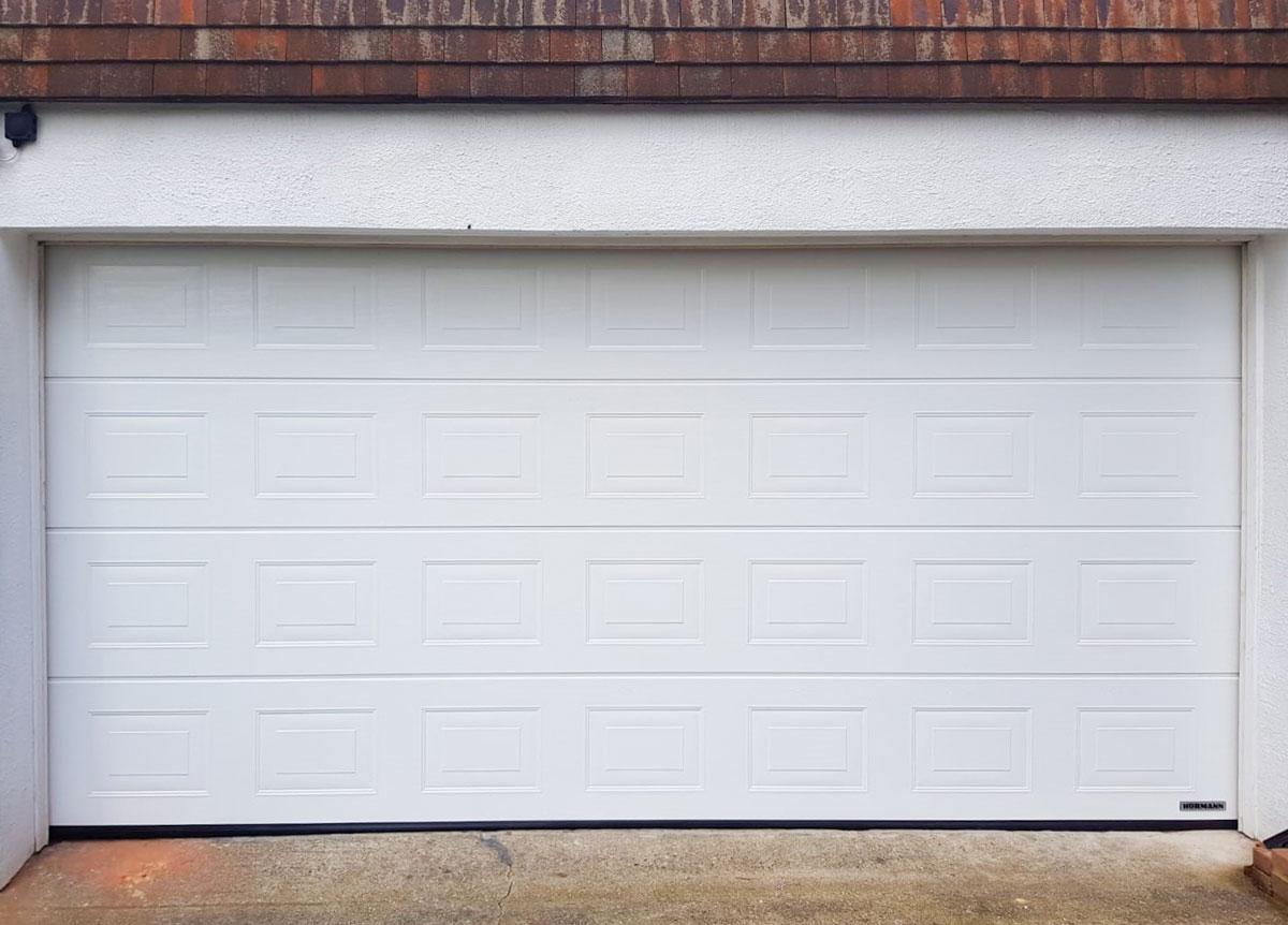 Hormann LPU42, S-Panelled, Sectional Garage Door in White Woodgrain